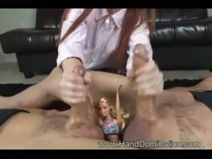 Redhead does a double handjob race free