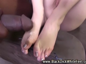 Interracial slut gives fetish foot play ending with a cumshot