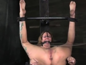 Mouth gagged bitch is being caned by powerful dominant