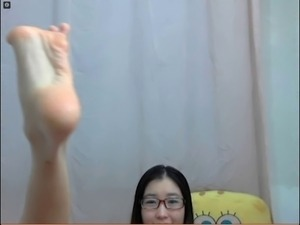 Chinese girl shows foot for webcam