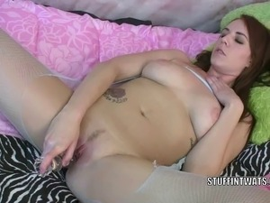 Horny hottie Alisha Adams in crotchless fishnets and stuffing her pussy with...