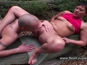 A kinky couple view there pics before having sex outside