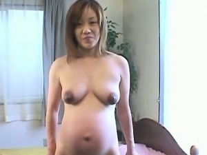 Busty preggo asian milf naked close up
