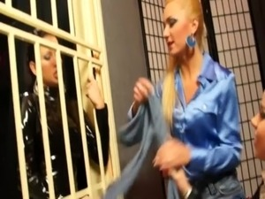 Lesbo gets strapon fucked while behind bars free