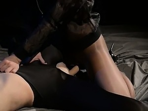 Blindfolded babe gets fuck by strap on