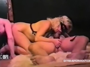 Master watches how three of his obedient slaves have sex with each other. He...