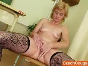 Foxy mamma teacher has on glasses and masturbates herself like crazy in a...