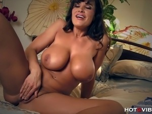 The legendary MILF, Lisa Ann, plays with her enormous, natural breasts and...