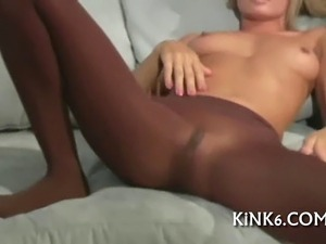 Horny gal in black tights strokes feet and tickles glorious bean