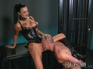 Muscular sub is caged and humiliated by Mistress
