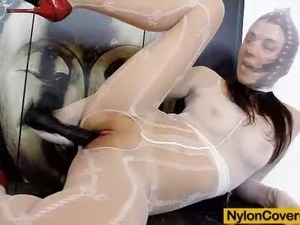 Freaky brunette deforms her face with a nylon mask while riding a huge...