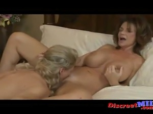 Two MILFs kiss lick and fuck each other and squirt all over