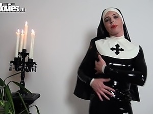 Slutty latex nun rubbing her kinky latex costume