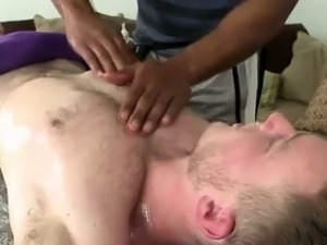 Naked muscled hunk gets massage at gay spa