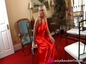 Courtney B looking gorgeous in slinky evening dress and black stockings.