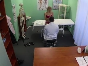 Foxy blonde patient getting felt up by her doctor