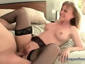 Fantastic blonde cougar whore with huge tits and sexy body