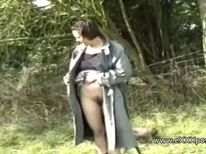 Woman in a field exposes her panties and boobs