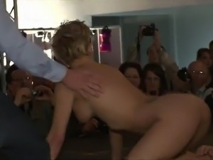 Busty tattooed blonde stripping and dancing slutty at strip show