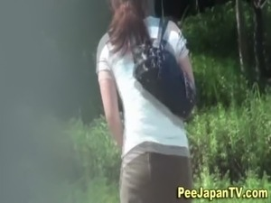 Asian lady pees on tree free