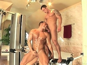 Three muscular men in a gym. They suck, fuck and cum hard!