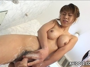 Dreamy Japanese slut with big natural hooters slurps her lover's hard dick....