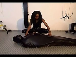 Slutty black slut tries out some kinky clothes