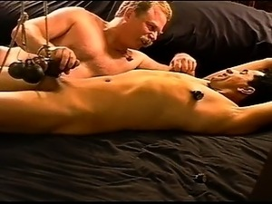 CBT bottom is restrained and weights cause rope to pull on his balls as I...