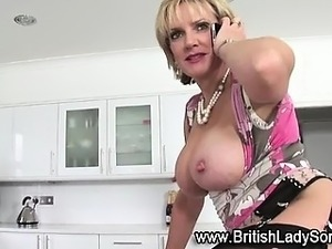 Lady Sonia fucks dildo in stockings
