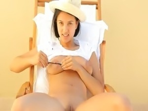 Busty woman torturing her nipples