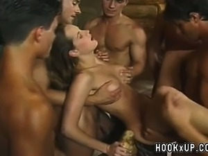 A crowd of men and a couple of girl