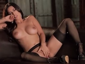 brunette with big breasts on brown sofa