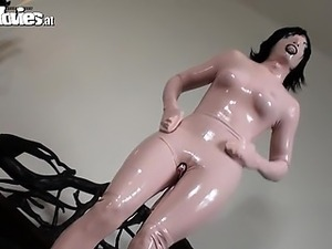 Babe poses in weird girl latex costume