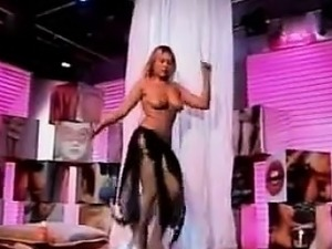 Busty Belly Dancer Gets Undressed And Dances
