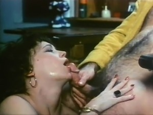 Lustful brunette giving her man a steamy blowjob