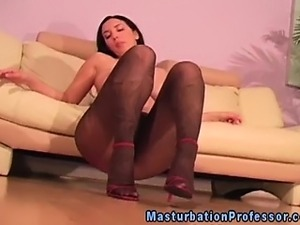 Pantyhose loving brunette touching herself