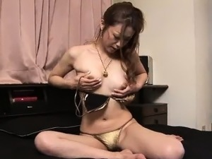 Gorgeous and horny Sakura Hirota plays with her tits and