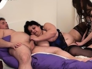Skinny babe strap on fucks a fatty in a foursome