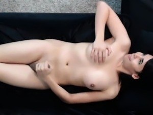 Sexy shemale pleasuring herself on her couch.
