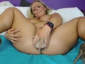 Blondie strips and fucks her toy