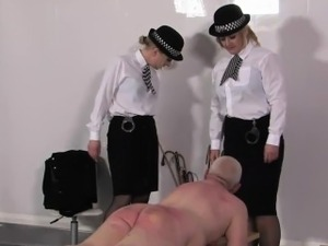 Police femdoms spanks subs butt with objects
