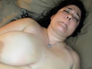 Huge MILF pleasing her hairy pussy