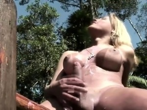 Tgirl slut with massive tits pumps shecock into milk bottle