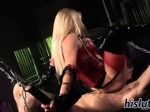 Latex-clad bimbo rides on a stiff shaft