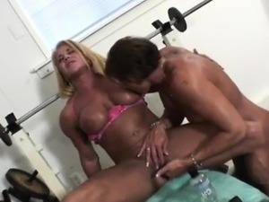 Buff Woman Satisfies Her Gym Partner