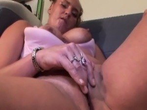Mature cutie teasing nipples and wet pussy
