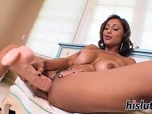 Attractive Priya slides a dildo in her twat
