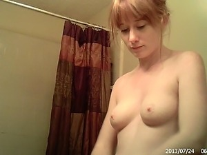 Cute wife is getting dressed in the bathroom and caught on