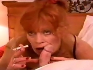 Classic Hot Redhaired Cougar Smoking BJ