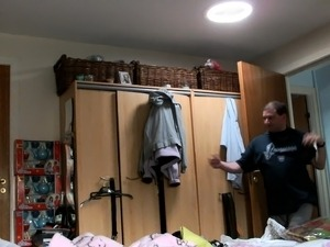 He sets up the hidden cam and goes in to make sure she in t